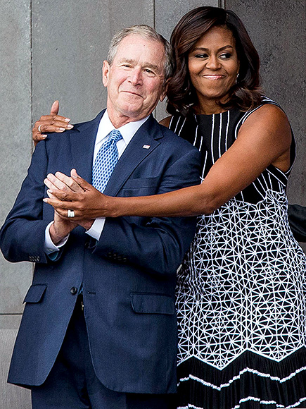 Former US President George W. Bush receives a hug from US First Lady Michelle Obama as they attend the opening ceremony for the Smithsonian National Museum of African American History and Culture on September 24, 2016 in Washington, D.C.  / AFP PHOTO / ZACH GIBSONZACH GIBSON/AFP/Getty Images