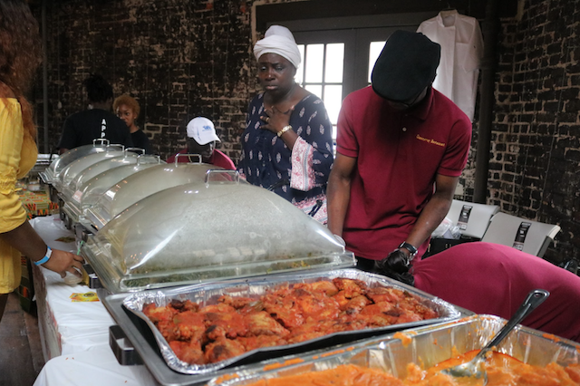 Nigerian-Ms.-Atinuke-Ogunsalu-of-Queensway-Restaurant-Catering-with-hands-on-chest.png